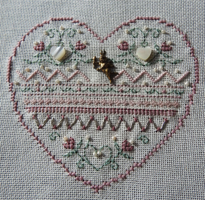 Heart With Small Bronze Cherub Cross Stitch Pattern - Completed And Unframed -
