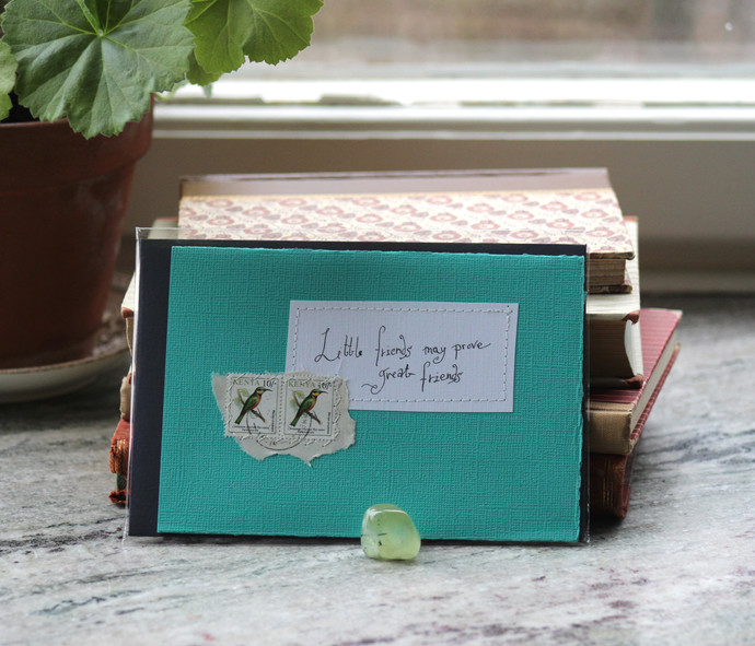 Little friends may prove great friends - Green card with handwritten quote and