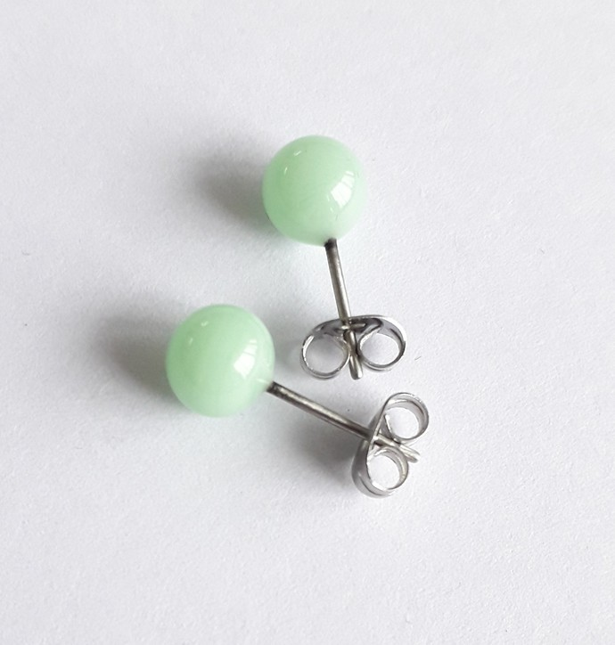Earstuds in minty green, lampwork glass on surgical steel