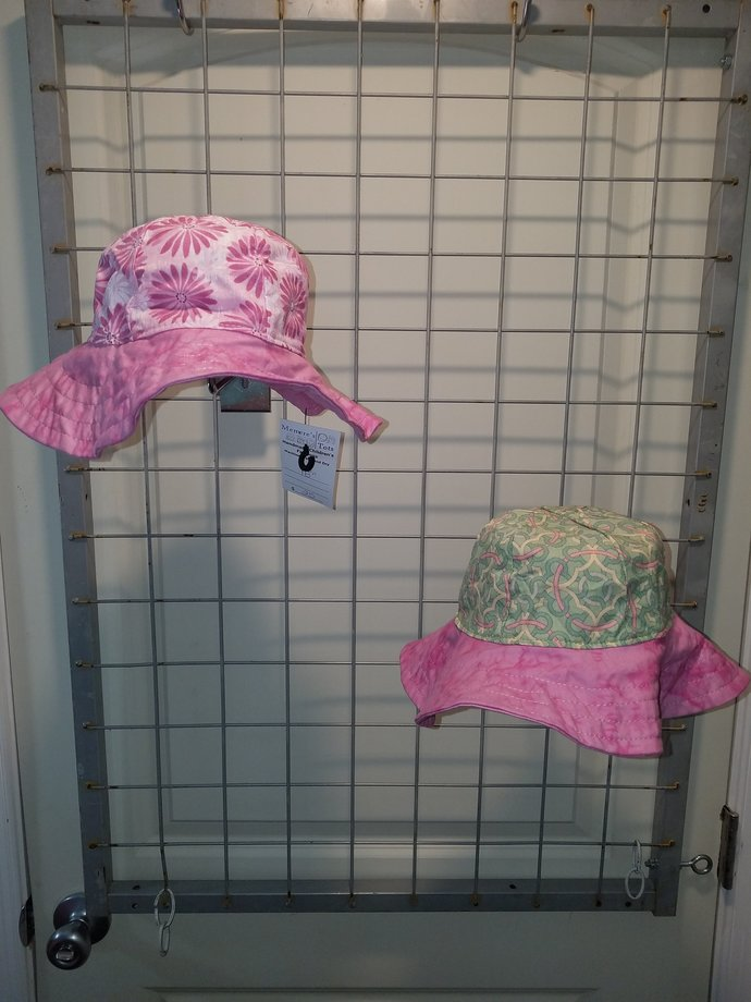 Reversbile Sun Hat pink daisy and green geometric print with pink brim