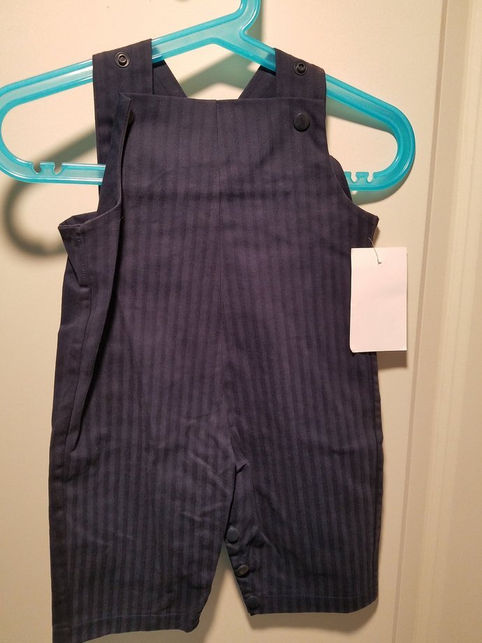 Long overalls in navy herringbone stripe can be personalized