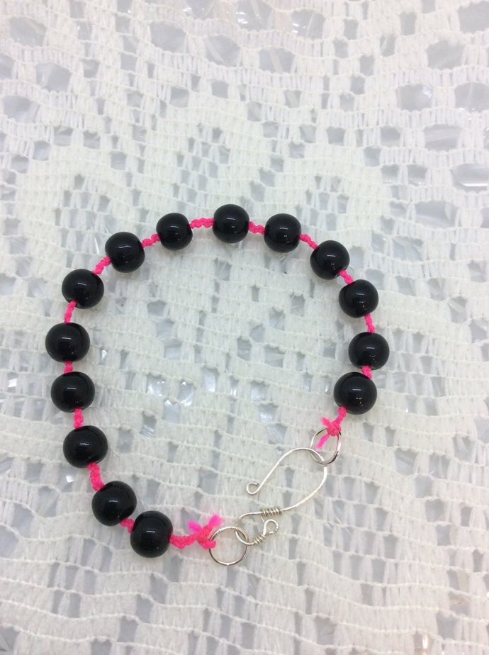 Hand Knotted Black and Hot Pink bracelet with wire wrapped clasp