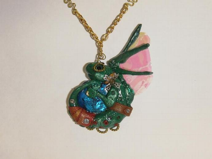 steampunk dragon pendant with decorative gold chain, beads, wire wrapping