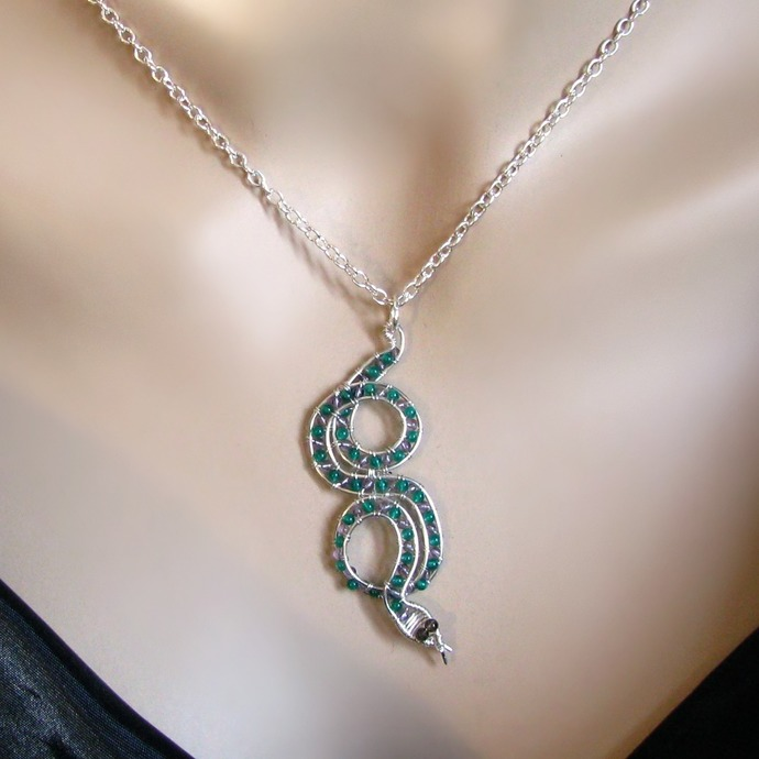Wire wrapped silver snake pendant with gemstones