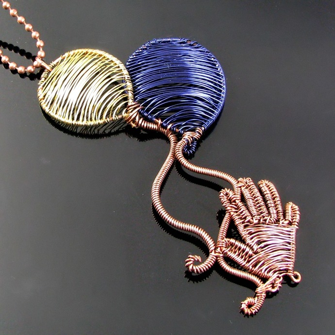 Unique wire woven hand with balloons pendant