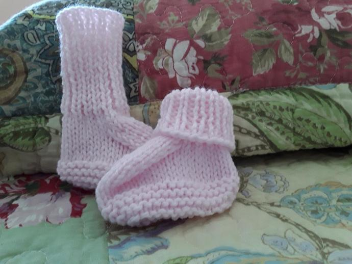 Adorable pink booties for the special little girl in your life.  Hand knitted