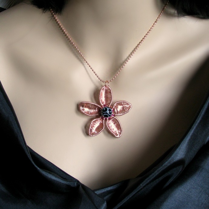 Wire woven rose gold flower pendant with lampwork