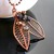 Wire woven leaf pendant with lava and glass beads