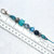 Zipper Pull or Charm, beaded in Blue, Black and Silver colors with sparkle