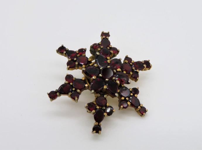 Antique Victorian Bohemian Garnet Star snowflake brooch flat cut in gold gilt.