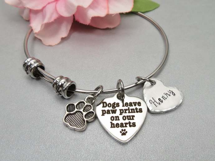 Dogs Leave Paw Prints on our Hearts Bracelet. Personalized Custom Hand Stamped