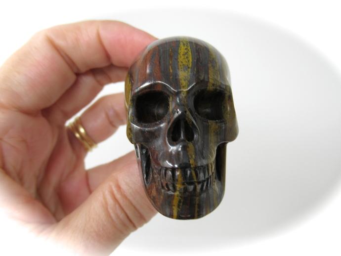 "Tiger Eye Iron Carved Crystal Skull 2"" 117g"