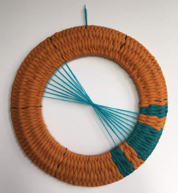 Hand woven yarn wreath