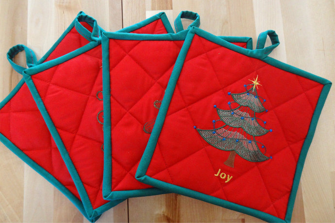 Embroidered Christmas Tree Themed Pot Holders With a Green Binding