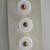 """Original card of 11/16"""" White Glass Buttons with Gold Luster Cone in Center"""