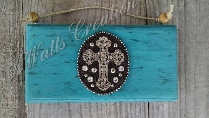 Distressed turquoise cross hanging sign