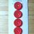 """11/16"""" Red Glass Buttons with Gold Luster 7439-8"""
