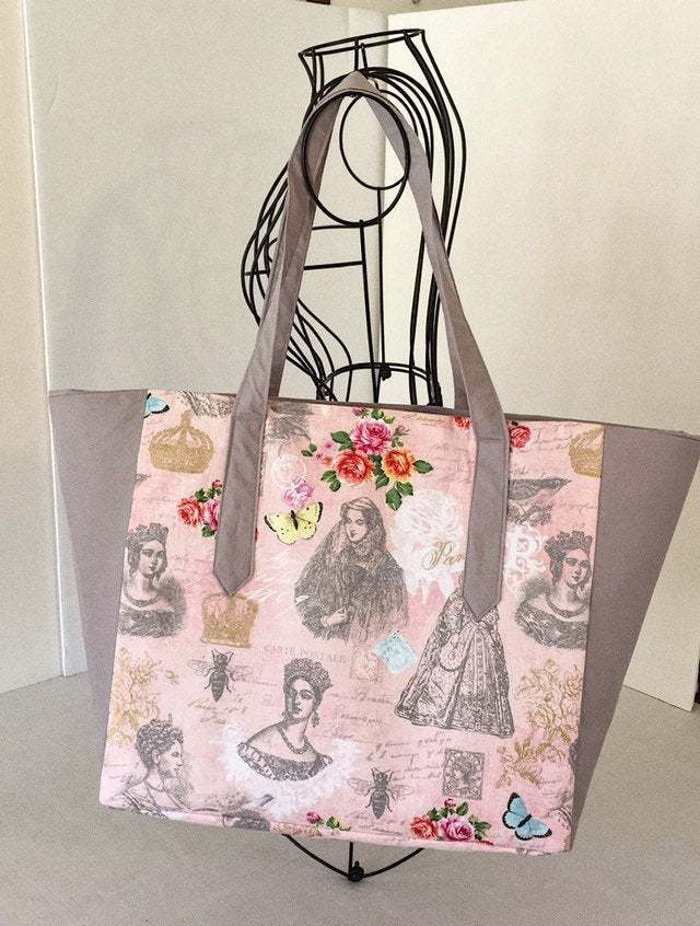 Pink royal ladies print tote bag with zipper closure and inside pockets pink