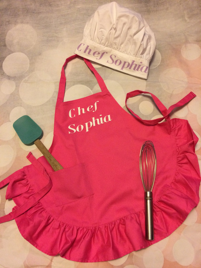 Personalized girls aprons with chefs hat. 1 front pocket,  Teach your child to