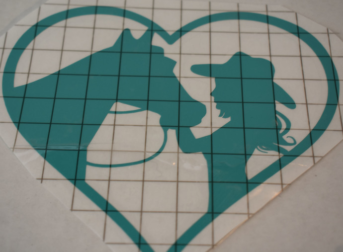 Cowgirl and Horse Heart vinyl decal for indoor and outdoor use.  LIght Turquoise