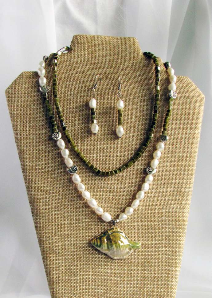 Necklace. Green Ceramic Conch Shell Pendant on a Strand of Fresh Water Pearls