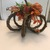 Fall Grapevine pumpkin tabletop decorated in green and oranges for