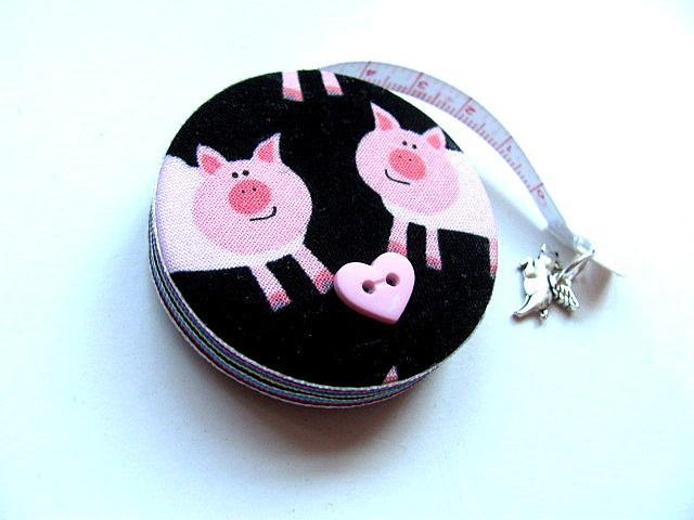 Tape Measure Pigs on Black Retractable Tape Measure