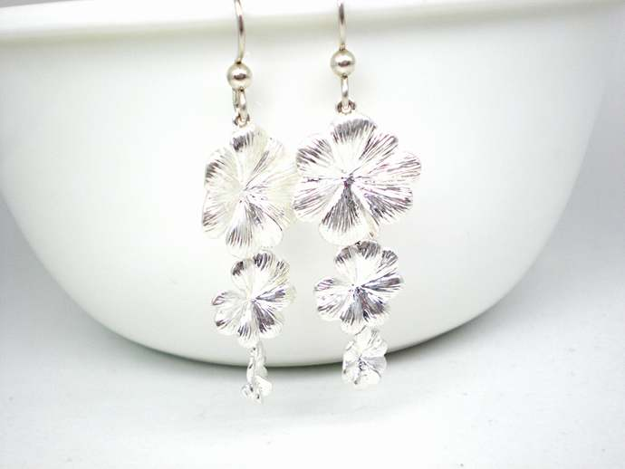 Silver flower statement earrings long floating blossoms three flower charms on