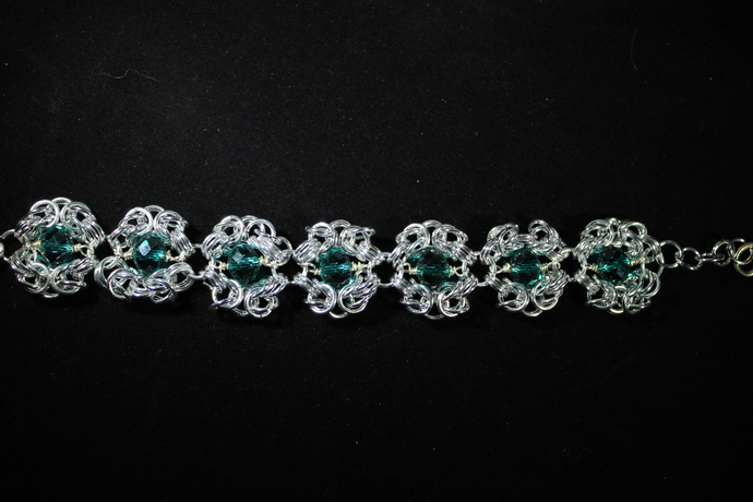Beautiful chainmail crystal bracelet with green crystal accents. Free shipping