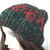 Hand Knitted Women'sDark Multicoloured Ribbed Winter Hat With A Cream Faux Fur