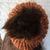 Hand Knitted Women's Orange And Brown Winter Hat With A Dark Brown Pom Pom -