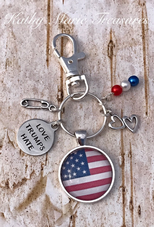 Love Trumps Hate silver key chain with stainless steel charm, American flag with