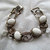 Vintage jewelry bracelet with white cabs and silver colored metal links