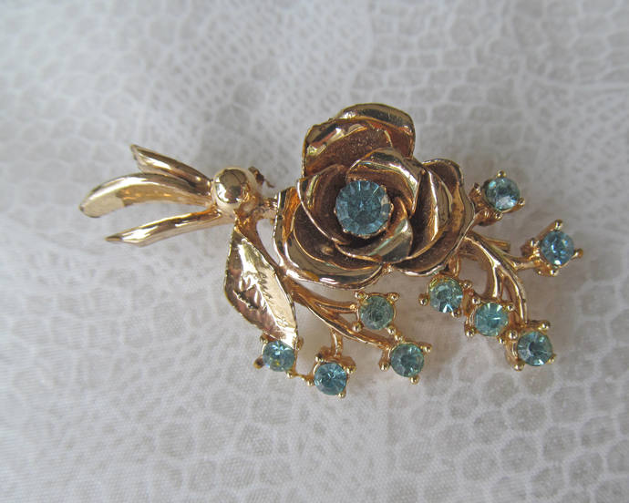 Coro signed vintage rhinestone and gold colored metal brooch
