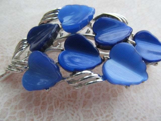 LISNER signed brooch of royal blue Lucite set in silver colored metal