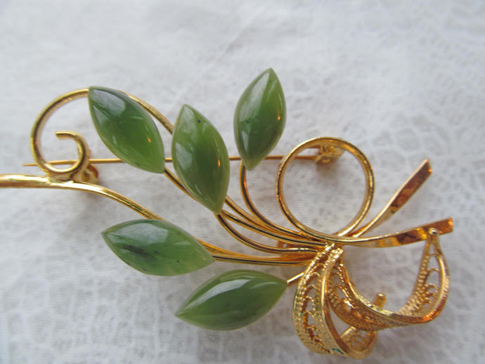 Signed Swoboda floral spray with genuine jade gemstones w gold colored metal