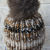 Hand Knitted Women's Brown And Cream Random Winter Hat With A Brown Pom Pom -