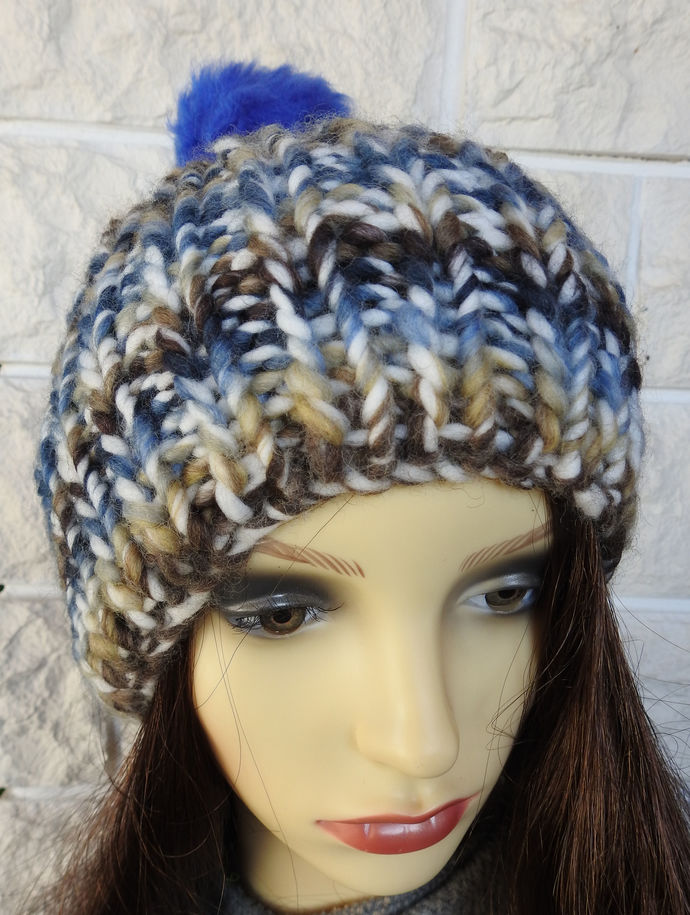 Hand Knitted Women's Blue, Brown And Cream Random Winter Hat With A Blue Pom Pom