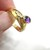 Amethyst and diamond ring in 14k yellow gold, bezel set gemstones in an offset