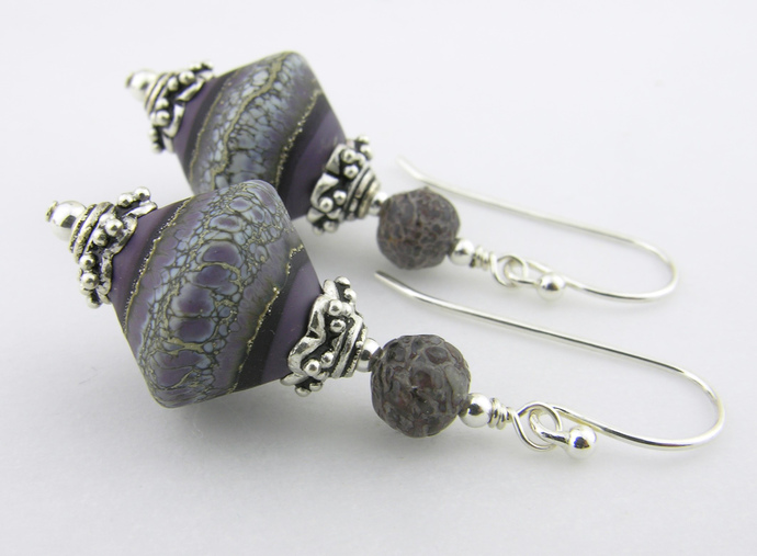 aged purple artisan lampwork, petrified dinosaur bone and sterling silver earrings