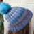 Hand Knitted Women's Two Style Random Blue And Grey Winter Hat With A Blue Pom