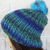 Hand Knitted Women's Random Blue And Green Ribbed Winter Hat With A Blue Pom Pom