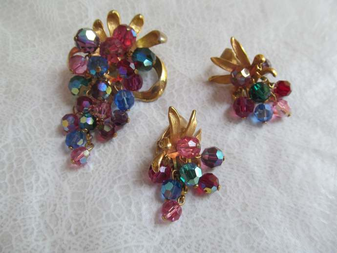Vintage dangle brooch and earrings of colorful AB beads and gold colored metal