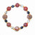 Bracelet, stretch, beaded in Copper Canyon colors with black, gold, and crystal
