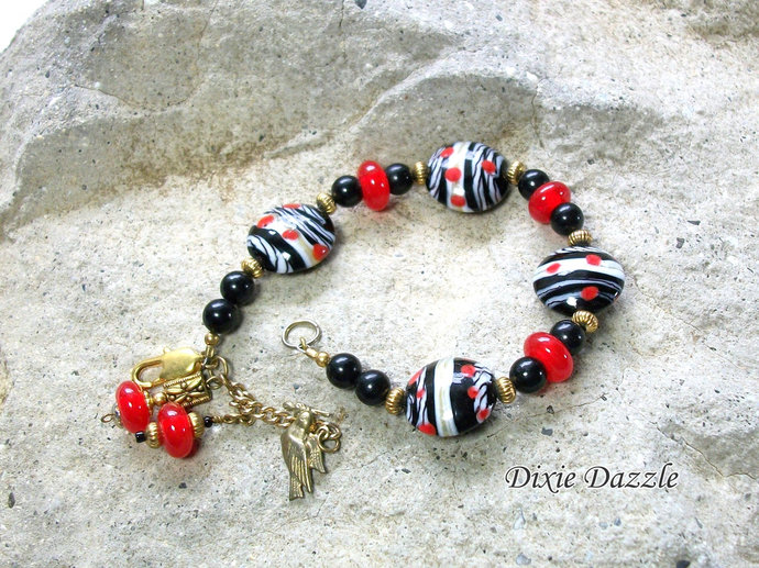 Red and black bracelet with lamp work beads and black onyx bracelet with charm