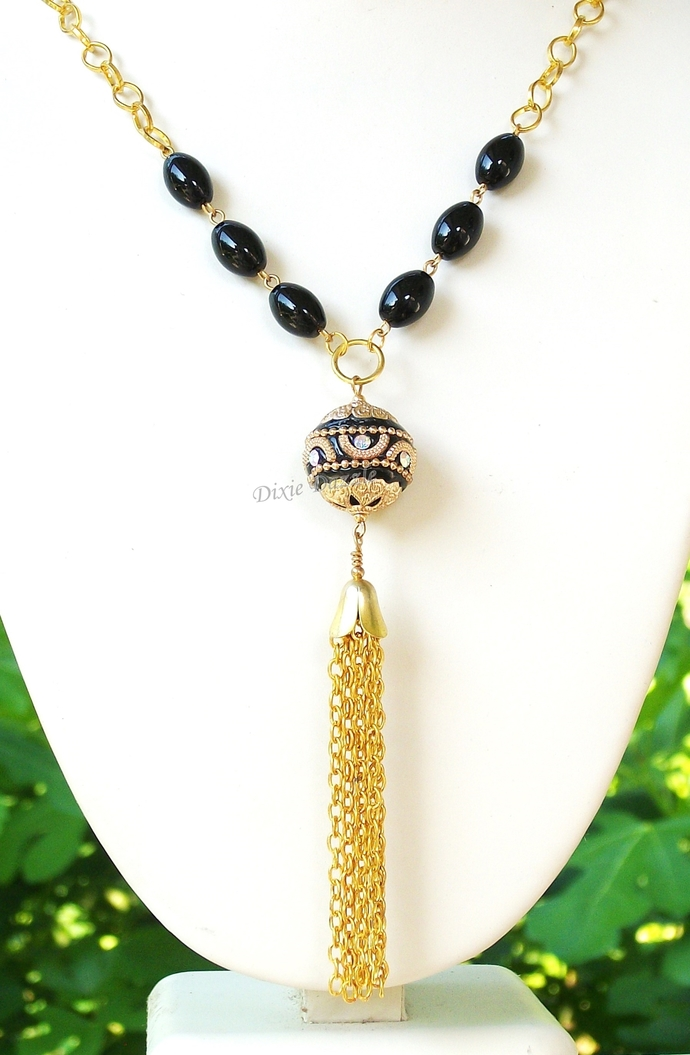 Special occasion jewelry, elegant  black and gold necklace, black dress
