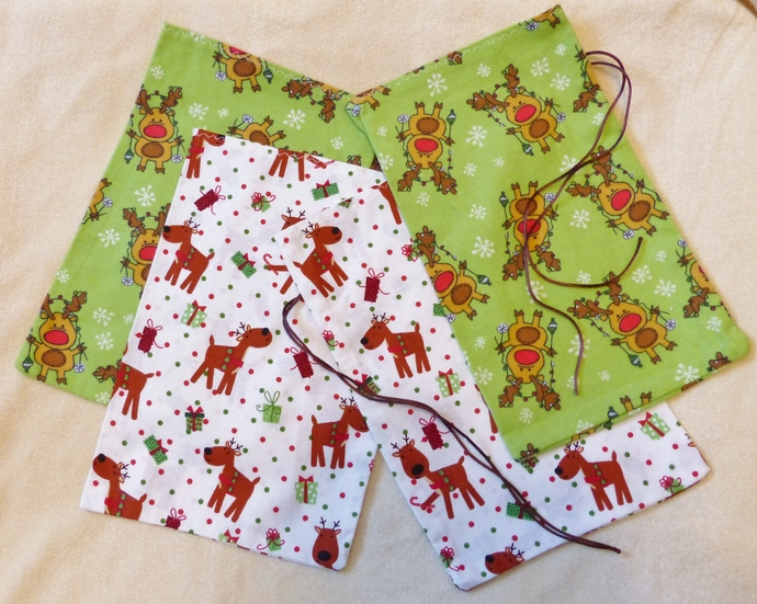 Fabric gift bags. Set of four bags, Holiday Reindeer fabric, Holiday gift bags,