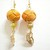 Orange drop earrings, twine wrapped beads with gold leaf dangles, gold tone