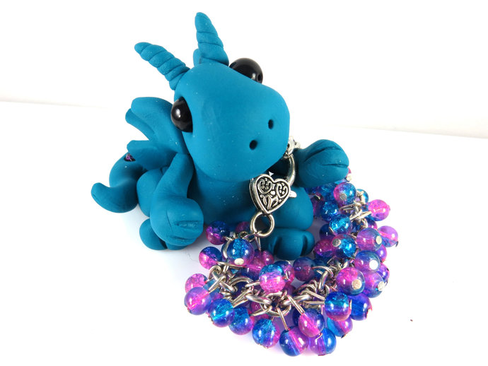 Clay teal dragon with girls pink & blue cha cha bracelet