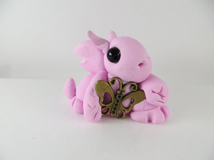 Pink clay baby dragon with butterfly